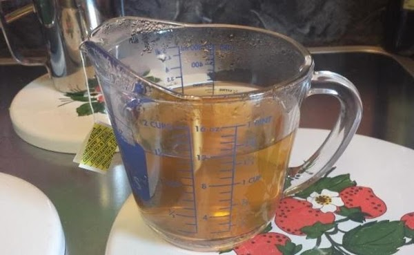 Make tea: pour the almost-boiling water over teabags in a heat-proof container and steep...