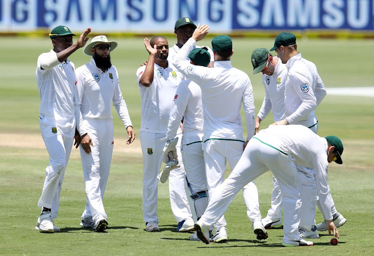 Vernon Philander of South Africa celebrates with teammates after Faf du Plessis catches out Ashwin Ravichandran of India during the 2018 Sunfoil Test Series match between South Africa and India at SuperSport Park, Centurion South Africa on 15 January 2018.