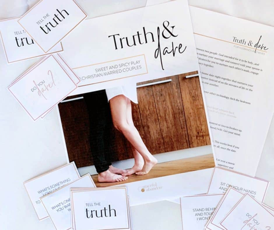 Truth & Dare Printable Date Night Game laid out on bed ready to play