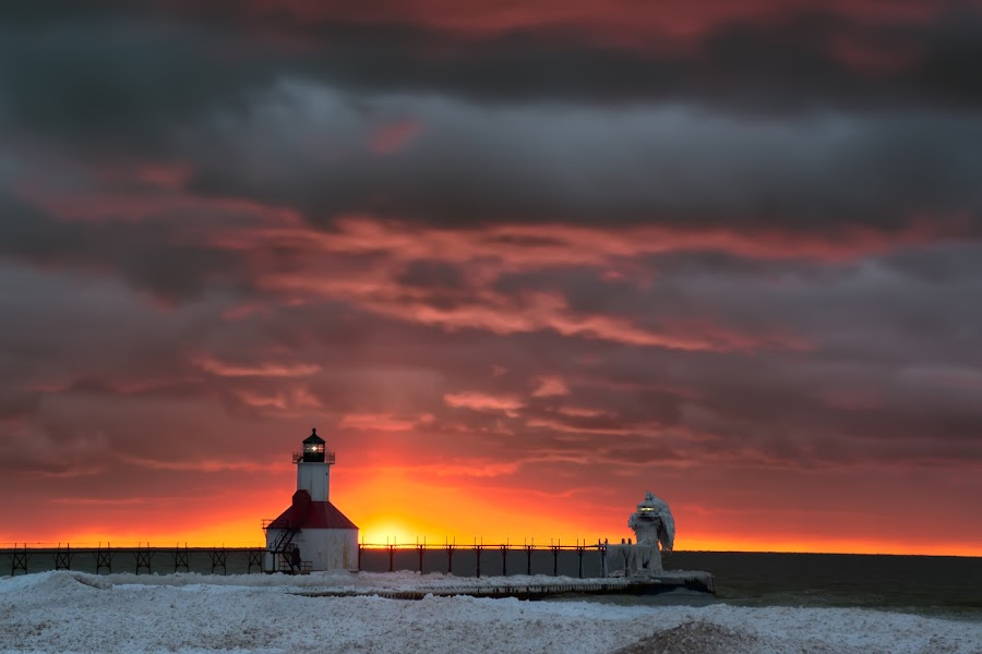 Break on through by Cliffie Scott-Williams - Landscapes Sunsets & Sunrises ( lakes, architecture, glow, nightfall, wintertide, wintertime, lights, geographic features, snow, weather, evening, construction, clouds, building, sun set, twilight, lighthouse, science & technology, dusk, united states, michigan, lake michigan, winter, north america, season, seasons, sunset, sundown,  )