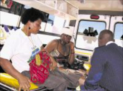 INJURED:Hawkers receiving medical attention from health workers after injured during the clash with police. Pic: Chester Makana. 04/08/2009. © Sowetan