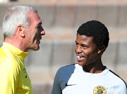 Kaizer Chiefs head coach Ernst Middendorp shares a joke with his exciting young midfielder Happy Mashiane during a session at their training base in Johannesburg on May 15 2019.