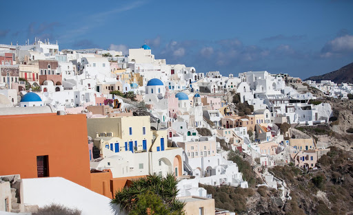 View of the picture-perfect sugar-cube buildings in Oia on the Greek island of Santorini, looking south.