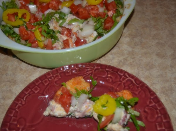 Remove from oven and top with shredded lettuce, tomato, onion and pepper rings.