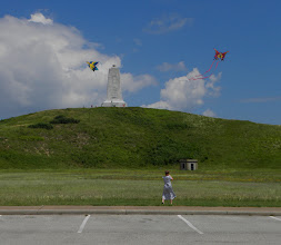 Photo: A young lady flying her kite in front of the Wright Memorial
