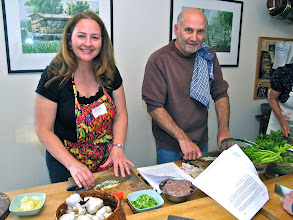 Photo: Gina and Mark chopping garlic for the pork rice soup