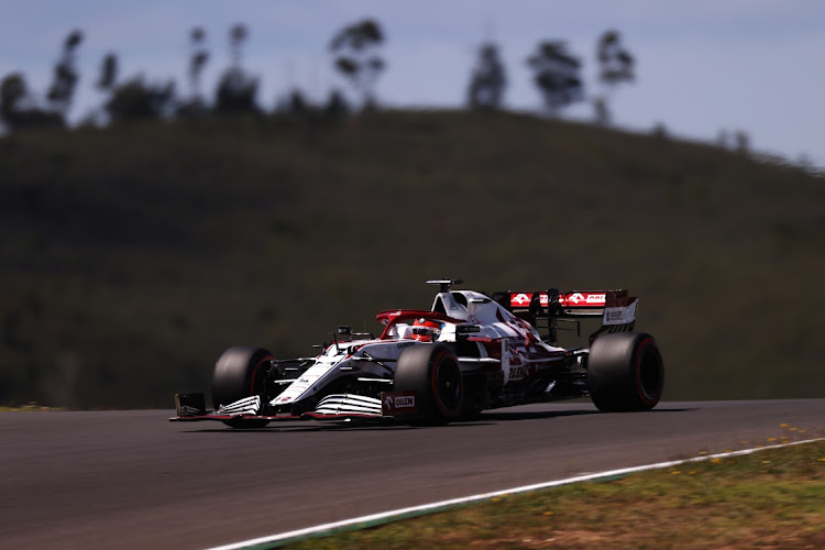 Kimi Raikkonen of Finland driving the (7) Alfa Romeo Racing C41 Ferrari on track during qualifying for the F1 Grand Prix of Portugal at Autodromo Internacional Do Algarve on May 01, 2021 in Portimao, Portugal.