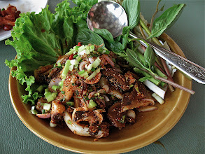 Photo: northeastern-style hot-and-sour cuttlefish salad with toasted rice, Yok Yor