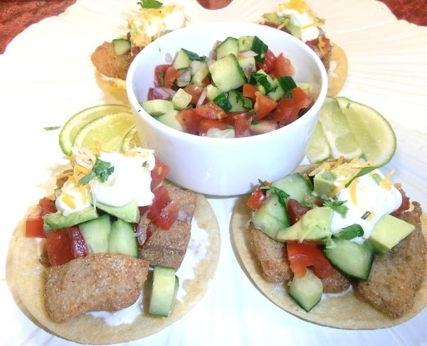 Assemble:  tostado, fish, pico, mexican crema.  Garnish with cheese and cilanto.