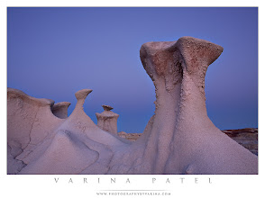 Photo: Waiting for the Night  #PhotographyTips, #NewMexico, #BistiWilderness, #Travel  Have you ever taken a photo at twilight? Were you happy with the results?  We found these gorgeous Hoodoos in the Bisti Wilderness reserve in New Mexico. This was such a fantastic location. It's the kind of place you could just wander in for hours. Actually. We did wander around for hours. And we would have liked to stay a lot longer - climbing over one ridge after another, discovering bizarre formations and crazy patterns in the rocks, searching for interesting composition... what a place!  This was the last shot I took that day. I set up my camera to shoot these strange, smooth hoodoos - but I wanted something different. Rather than shooting in broad daylight, or during the golden hours, I decided to take the shot at twilight. This is the time after the sun disappears below the horizon - when there is still a soft, glowing light remaining. And before it is truly dark. I wanted a slightly strange light to add to the bizarre scene... but I wanted the light to be very subtle and smooth to compliment these beautiful hoodoos.  So, I set up my composition and waited for the light to do what I wanted. (And believe me, waiting around in a place like this is no chore... so much to look at!) When the light was soft enough - and I could see a touch of pink in the sky behind the hoodoos, I fired off a 3.2 second exposure. No good. The hoodoos were too dark. So, I pulled out my headlamp, fired off another exposure, and gave the hoodoos a pass or two with my lamp. I had to take a few shots to get the light even on the foreground... and to avoid the harsh shadows that directional light produces. For this final shot, I made sure I was far enough back with my light to avoid bright spots, and I moved the light from side to side to reduce those shadows.  Although dramatic sunbeams and brilliant sunsets can be striking in a photograph - I sometimes prefer more subtle light. Especially when the landscape is dramatic on it's own.