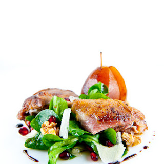 Sous-Vide Duck Confit with Pomegranate Poached Pear & Mache Salad