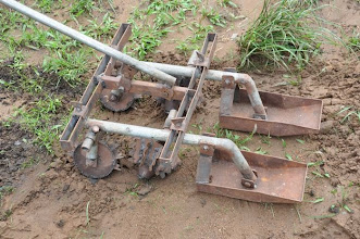 Photo: WARC has produced weeders for SRI from technical drawing only. [Photo by Erika Styger, July 2012]