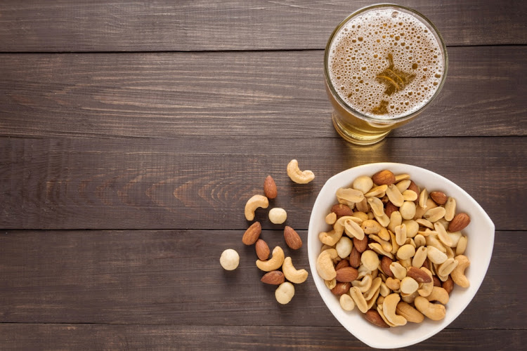 A snack while you're out can do you a world of favours - nuts can deliver a selection of B vitamins, which get rapidly depleted when you drink.
