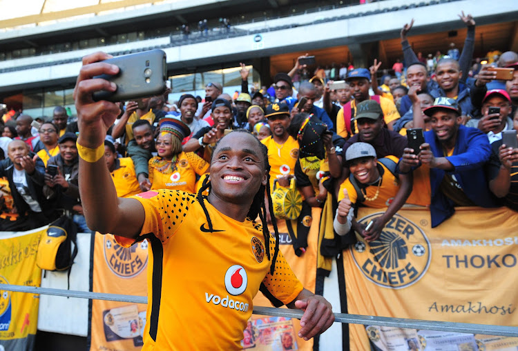 Siphiwe Tshabalala of Kaizer Chiefs takes a selfie with fans after the Absa Premiership 2017/18 game between Ajax Cape Town and Kaizer Chiefs at Cape Town Stadium on 12 May 2018.