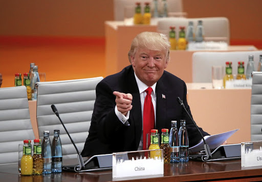 US President Donald Trump gestures as he sits at the table during a working session at the G-20 leaders summit in Hamburg, Germany July 8 2017. Picture: REUTERS/WOLFGANG RATTAY