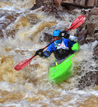 Photo: Kayaker Anthony Collins of Oshkosh, Wisc., makes his way down the Naked Man rapid on the Lester River.