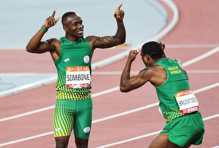 South Africa's Akani Simbine wins the 100m as Henricho Bruintjies who finished second looks on. Atheltics. Carrara Stadium. Commonwealth Games, Gold Coast, Australia. Monday 9 April 2018.