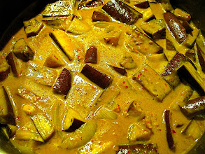 Photo: cooking eggplant in yellow curry sauce