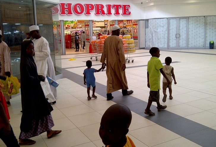 A family passes a newly-opened Shoprite supermarket in Nigeria's northern city of Kano. Picture: REUTERS