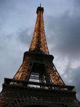 Photo: Long lines discourage a trip up, so we watch the Tower come alive from the Champs de Mars.