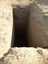 Photo: Looted shaft tomb.