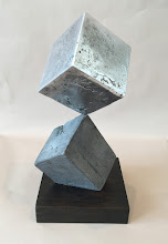 Photo: BALANCING ACT 2 - CUBE ON RHOMBOHEDRON 13H X 6W X 7D Lost Foam Aluminum Casting, Stained Ipe, Interactive Kinetic, Rear View