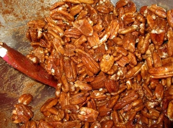 Stir in Brown sugar, cinnamon, cloves, ginger and vanilla. Add nuts; stir to coat.