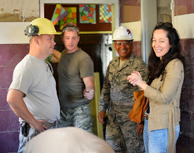 Photo: Diana Marsic, right, meets with U.S. Air Force Airmen at an elementary school in Ogulin, Croatia, June 26, 2014. The school bathrooms are being renovated by Airmen from the 133rd and 148th Civil Engineering Squadron, and 219th Red Horse Squadron in partnership with the Croatian Army. Marsic is from the Office of Defense Cooperation at the U.S. Embassy in Zagreb, Croatia. (U.S. Air National Guard photo by Staff Sgt. Austen Adriaens/Released)