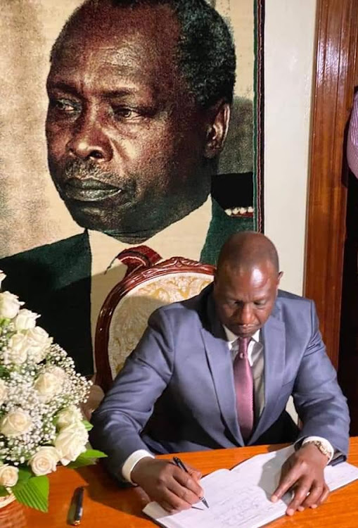 Deputy president registering his condolences in a visitor's book at the late President Moi's Kabarnet gardens home in Nairobi