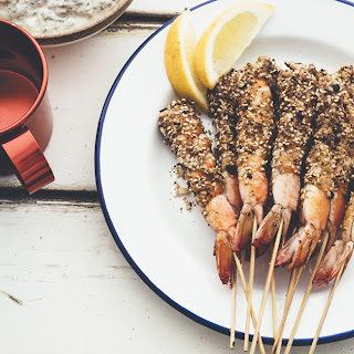 BBQ prawns with macadamia dukkah and mint lemon yoghurt.