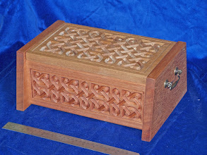 Photo: Simple Celtic knot pattern engraved in chunky wooden (red meranti) box.  Wooden boxes from the workshop of Karl Peet (BespokeCraft)email: enquiry@BespokeCraft.com; web: www.BespokeCraft.com