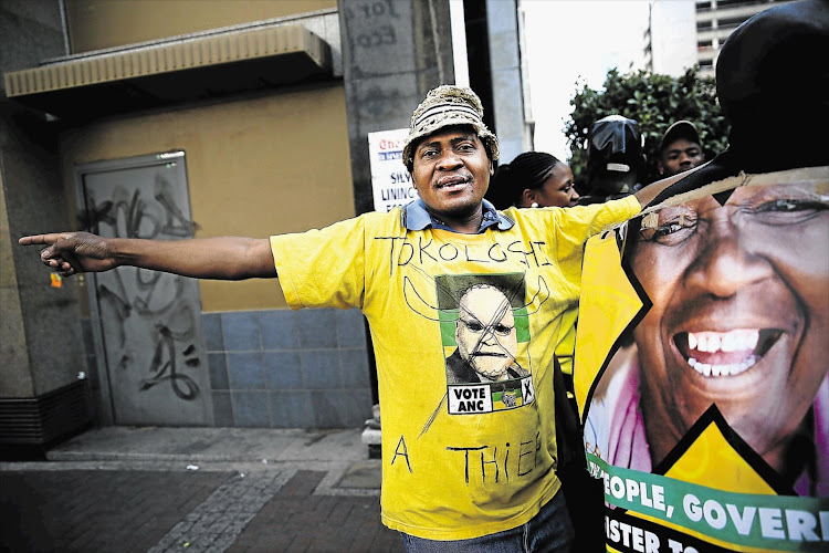 A man wears an anti-Zuma T-shirt outside Luthuli House in Johannesburg on September 5 2016.