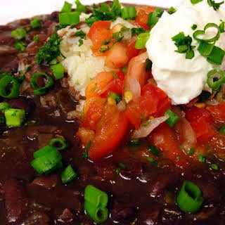 Savory Black Beans and Rice Topped with Sour Cream and Fresh Pico.