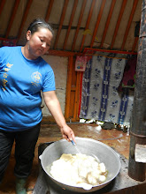 Photo: Frying boortsog. This is Amara, the mom of the host family. She's my age!
