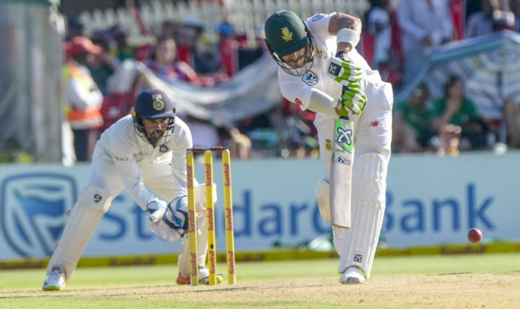 Captain Faf du Plessis of South Africa and wicketkeeper Parthiv Patel of India during day 1 of the 2nd Sunfoil Test match between South Africa and India at SuperSport Park on January 13, 2018 in Pretoria.
