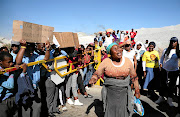 Pupils and parents from Carletonville  marched to Harmony Kusasalethu Gold Plant Mine yesterday, demanding that crime be dealt with in the area.  /SANDILE NDLOVU