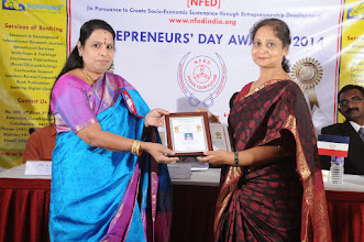Photo: Chief Guest Dr. V. Padmavathy Issing the Senior Woman Entrepreneur Award to Dr. Shilpa Datar, Director, Swayam Personality Assessment, Bangalore