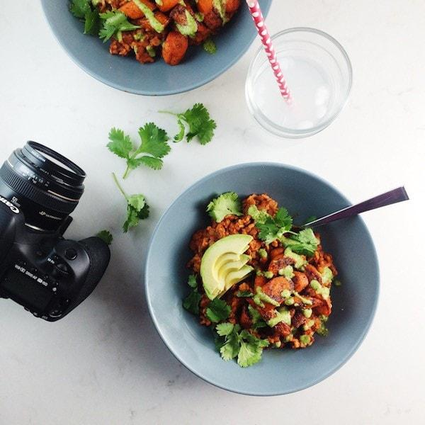 Camera and food in a blue bowl.