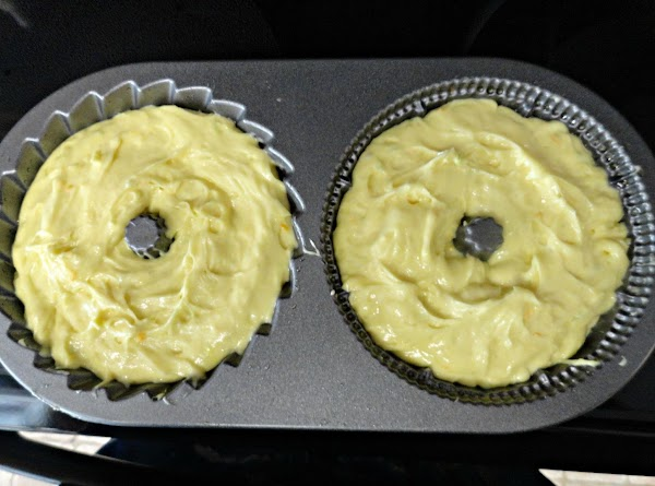 Spread cake batter into greased bundt pan or 2 small bundt pans.