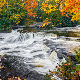 Upper Bond Falls in the Autumn by Kenneth Keifer - Landscapes Waterscapes ( stream, colorful, waterfall, falling, paulding, blur, landscape, leaves, nature, autumn, foliage, creek, state park, long exposure, rocks, september, upper bond falls, flowing, midwest, forest, scenic, woods, motion blur, bond falls, upper peninsula, michigan, blurred, wilderness, splashing, color, cascade, fall, trees, cascading, cataract, october, whitewater, ledges, river )