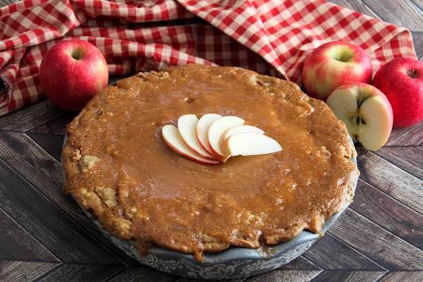 Caramel Glazed Soft Apple Pie Ready To Be Sliced.