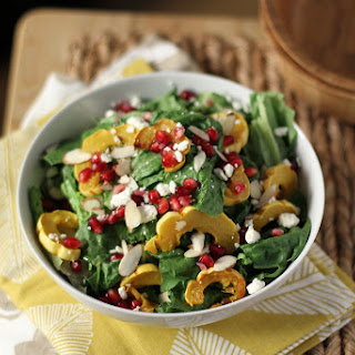 Roasted Delicata Squash Salad with Pomegranate Seeds and Spicy Maple Dressing