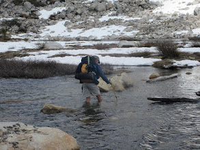 Photo: Matt crossing Lake Virginia inlet - first boots off crossing