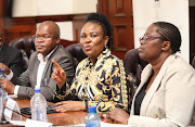 Public protector Busisiwe Mkhwebane flanked by her CEO Vusi Mahlangu and speaker Nontembeko Boyce at the KZN legislature on Wednesday.