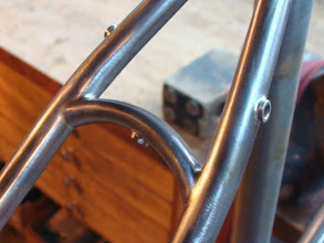 Photo: Nifty curved seat stay bridge along with a fender boss and rack mounts on the seat stays.