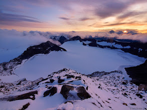 Photo: Storm clouds lifted just in time for me to capture this dramatic sunset on the snowy summit of Galdhøpiggen, the tallest mountain in Norway at 2469m (8100 ft.).  Jotunheimen National Park.