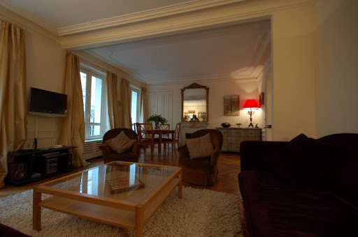 Bright living area at Rue Jean du Bellay Apartments