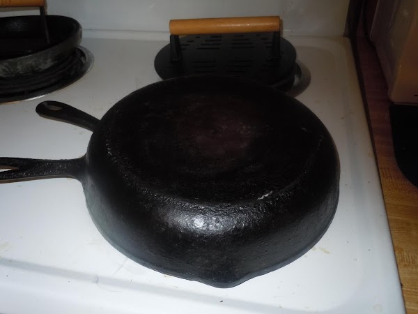 Put your iron skillet on top it melts the cheese really fast.