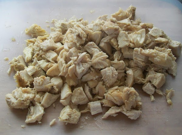 Cut the chicken into small bite size pieces and put into a large bowl.