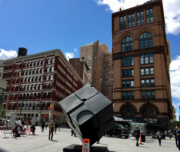 The Astor Place Cube in front of the former Clinton Hall Library.